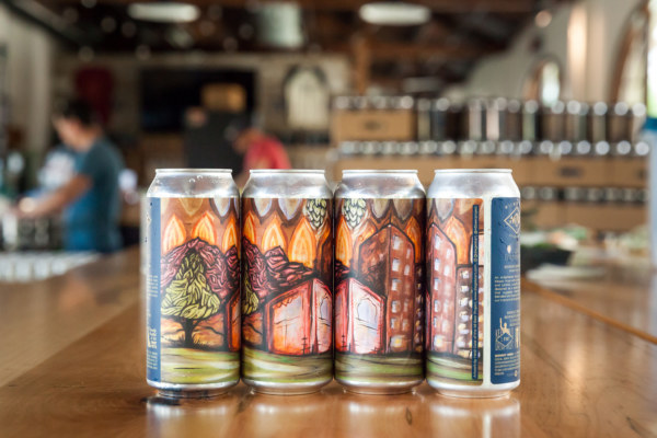 Lupulin Enlightenment image of a four pack of cans